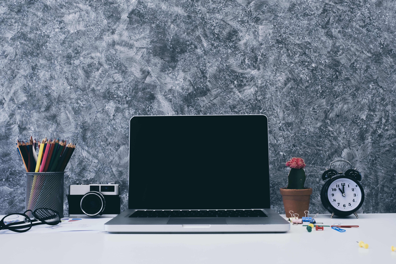 laptop on desk CRM strategy